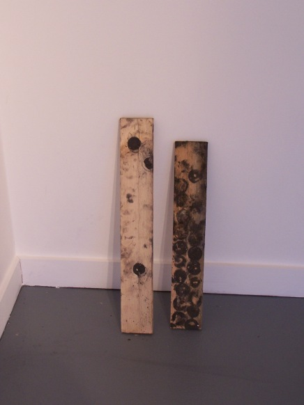 graphite ice on found wood, 2010